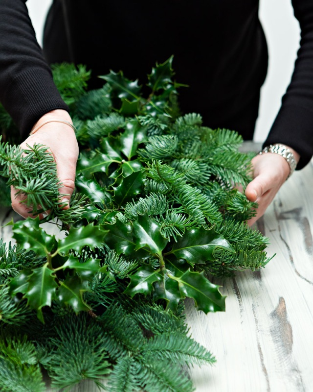 DIY-Christmas-Wreath-Step 1- Cover wreath in spruce and holy