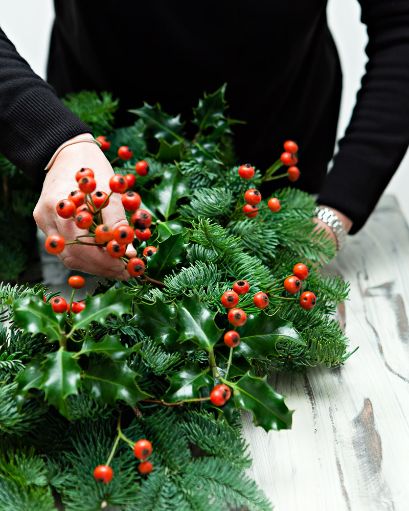 diy christmas wreath step 2 add the rosehips - How To Make A Christmas Wreath